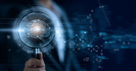 Businessman holding magnifying glass and digital brain, searching of a teamwork brainstrom for effective business Standard-Bild