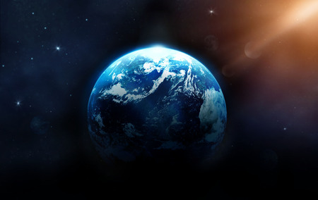 Planet earth with sun rising from deep space, Elements of this image furnished by NASA. Stock Photo