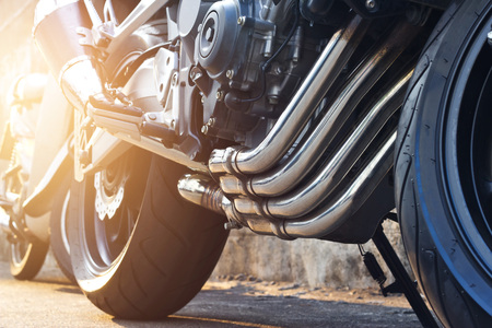 Modern motorcycle and exhaust details parking on the street background