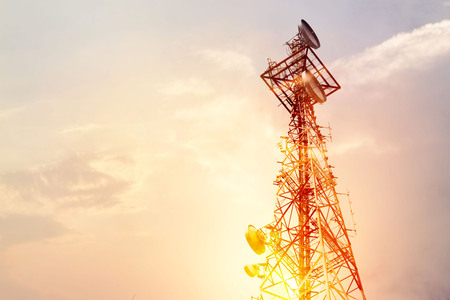 Abstract telecommunication tower Antenna and satellite dish at sunset sky background Stock Photo - 93619645