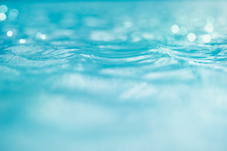 Water and bokeh light in the pool for background