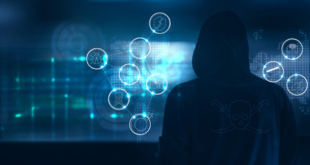 Hacker standing and prepare to attack with cyber crime icons on world map and screen binary code background