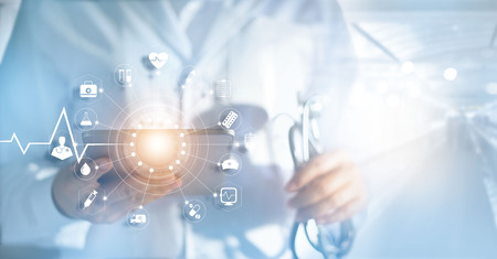 Medicine doctor and stethoscope in hand with icon medical network connection with modern virtual screen interfacein hospital background, medical technology network concept Standard-Bild