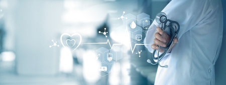 Medicine doctor with stethoscope in hand and icon medical network connection on  virtual screen interface. Modern medical technology and innovation concept Stok Fotoğraf