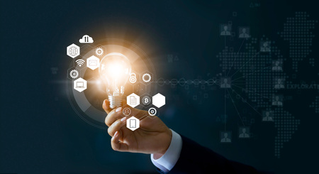 Businessman holding light bulb and new ideas of business with innovative technology network connection. Business innovation concept.