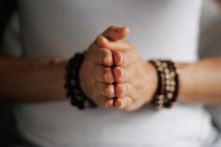 Woman hand yoga pose. Practicing meditation and praying indoors.