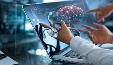 Medicine doctor team meeting and analysis. Diagnose checking brain testing result with modern virtual screen interface on laptop with stethoscope in hand, Medical technology network connection concept.