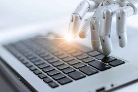 Robot finger point and working to laptop keyboard button, AI, Artificial Intelligence, Robotic hand on digital gray background. Futuristic technology concept.