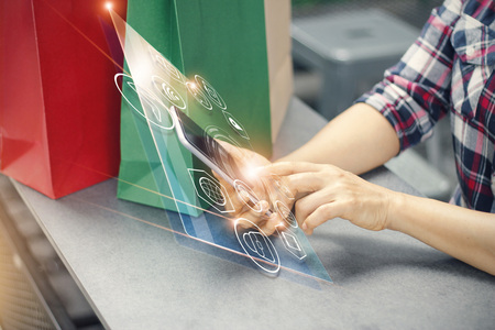 woman using mobile payments online shopping and icon customer network connection on virtual screen, m-banking and omni channel