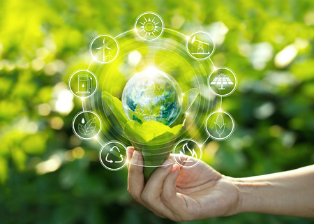 Hand holding light bulb against nature on green leaf with icons energy sources for renewable, sustainable development. Ecology concept. Elements of this image furnished by NASA. Banco de Imagens - 106927248