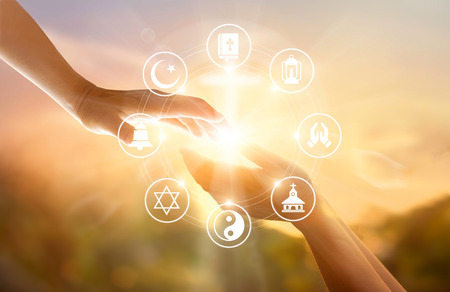Religion concept. Human hands together forgives and blesses. Praying and religions icon on sky sunset background Stock Photo