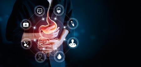 Man berührt Magen und Ikone medizinisch, leidet unter Magenschmerzen, Magen-Darm-Krankheit während der Arbeit Ursache von Stress von der Arbeit, Gesundheitswesen und Medizin-Konzept