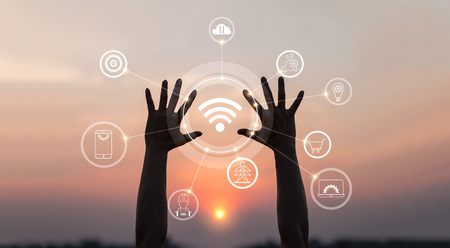 Hands with innovative icon and development of telecommunication, network connection in global communication networking on sunset background. Stock Photo