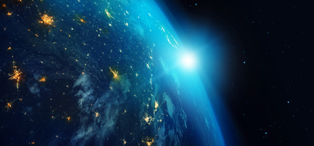 Earth from space at night with city lights and blue sunrise on stars background. 3d rendering.