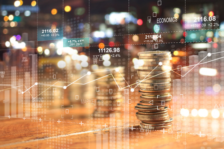 Double explosure with businesss charts of graph and rows of coins for finance at night city background. Archivio Fotografico