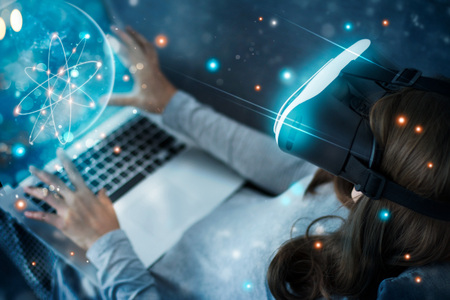 Woman with glasses of virtual reality planetarium. Science and learning have fun . VR glasses playing an exciting. Future technology and innovation concept.