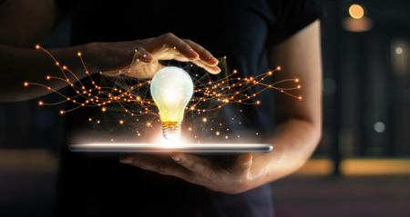 Abstract. Innovation. Hands holding tablet with light bulb future technologies and network connection on virtual interface background, innovative technology in science and communication concept Stockfoto