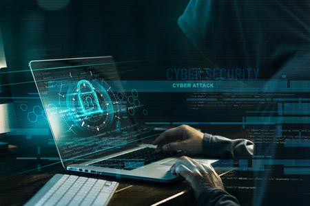 Concept de cybersécurité. Délinquance sur Internet. Hacker travaillant sur un code et un réseau avec icône de verrouillage sur fond numérique sombre de l'écran virtuel de l'interface numérique. Banque d'images