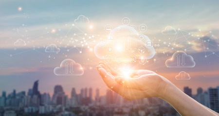 Cloud Computing Concept. Hands holding of Data protected exchange on sunset city background. networking connection. Big data and online storage. Cloud technology Imagens