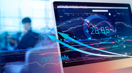 Financial data on a monitor. Investing and stock market gain and profits with graph charts, diagrams, growth, financial figures. Investor watching the change of stock exchange on tablet background