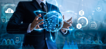 Businessman holding global data network and analyzing sales data and economic growth. Technology and business strategy. Digital marketing on interface hologram screen. Imagens