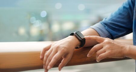 A man using his smart watch app, communication,  innovation and technology, business and network connection.