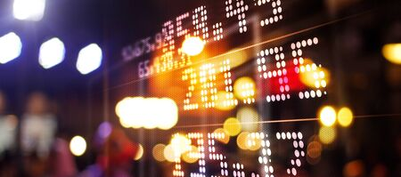 Stock market chart. Abstract graphic. Light of financial stock market numbers on night city and colorful