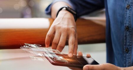Businessman working with mobile smartphone and icon network connection on virtual screen. Imagens