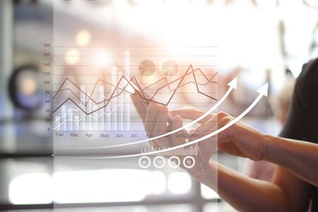 Hands using mobile and analyzing sales data and economic growth graph chart, payments, Digital marketing.