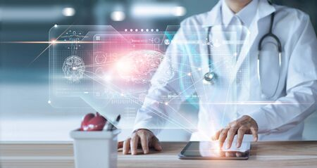 Doctor, surgeon Diagnose checking and analyzing patient brain testing result and human anatomy on technology digital futuristic virtual interface Imagens