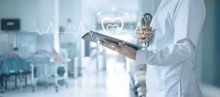Cardiologist doctor with stethoscope analyzing patient data on tablet with icon network connection on modern virtual screen networking interface, healthcare, medical technology and patient concept.