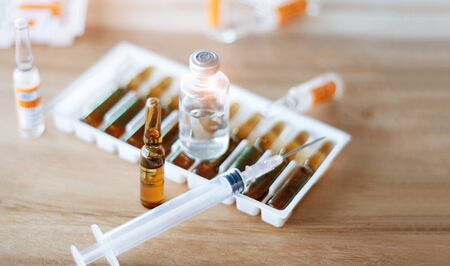 Medicine and syringe on table