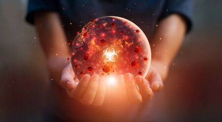 Man holding earth at night and disease contagious coronavirus or covid-19 outbreak on the world, Influenza crisis Stockfoto