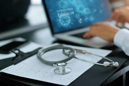 Stethoscope medical and doctor analysis coronavirus or covid-19 data on laptop computer on laboratory background. Stockfoto