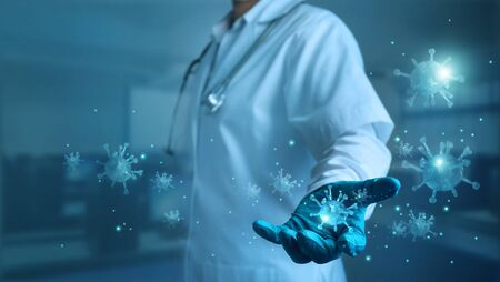 Abstract healthcare, Covid-19, Medicine doctor with stethoscope holding corona virus in hand and virus spreading on blue background, Coronavirus outbreaking and global epidemic virus . Stockfoto - 144898516