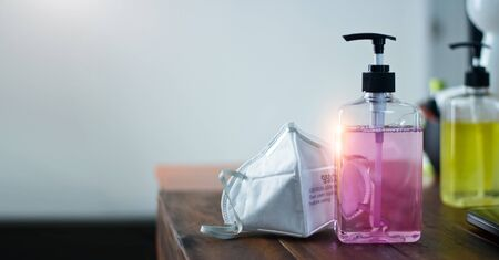 Gel for hand hygiene coronavirus protection, Hand sanitizer and  covid-19 prevention medical masks for stop spreading corona virus.