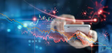 Economic crisis, Businessman using mobile smartphone analyzing sales data and economic graph chart that is falling due to the corona virus crisis, Covid-19, stock market crash caused. Stockfoto - 144898530