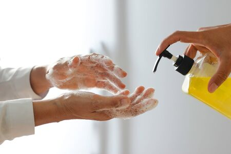 Hand sanitizer in family, Virus and illness protection coronavirus or covid-19 and flu outbreak. Stockfoto