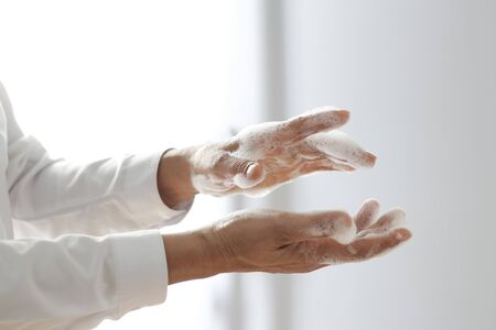 Man washing hands with soap gel for avoid infections corona virus or covid-19 and prevention for stop spreading coronavirus.