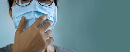 Women wearing virus mask protect of infection and spreading Coronavirus or Covid-19 on green Stockfoto - 145311362
