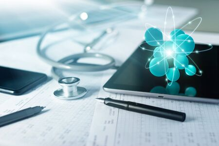 Abstract 3D networking on tablet with stethoscope with doctor's health data Report on table