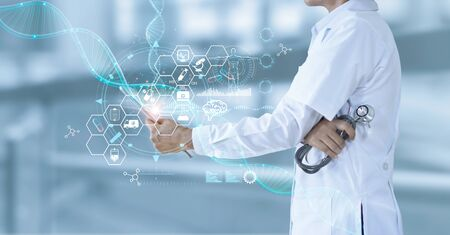 Medicine doctor holding electronic medical and record on tablet. DNA. Digital healthcare and network connection on hologram modern virtual screen interface, medical technology and futuristic concept. Stockfoto