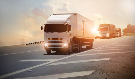 Logistics import export and transport industry, Semi trailer truck on a highway driving on sunset background Stockfoto - 149622436