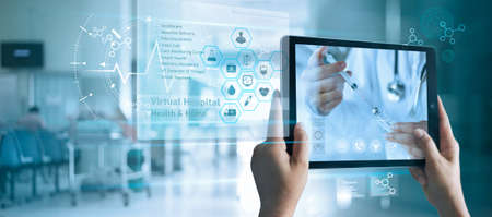 Virtual doctor concept, The patient holds a tablet. Consult and receive advice and analysis health from doctor online on virtual interface. Virtual hospital and online therapy.