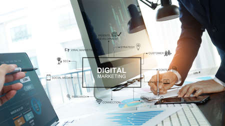 Digital marketing, Business team writing information and analysis sale data and graph growth, Banking, Strategy and planning of business on network connection, Solution analyzing and development contents. Archivio Fotografico