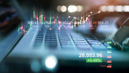 Double exposure of forex graph growth. Stock market. Businessman using laptop of financial data analysis on blue background. 版權商用圖片 - 161884024