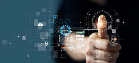 Businessman using fingerprint indentification to access personal financial data. for E-kyc (electronic know your customer), biometrics security, innovation technology against digital cyber crime 版權商用圖片
