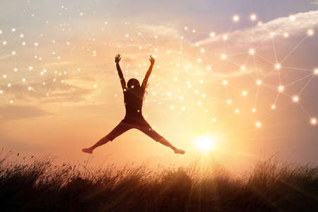 Happy woman with freedom manner in nature sunset and graphical network connection background. Idea for intelligence technology in global network enables people life more smarter and comfortable. 版權商用圖片