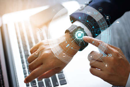 Businessman touching smart watch finding and research of digital marketing sales data on global network, Technology and innovation, Financial and banking.