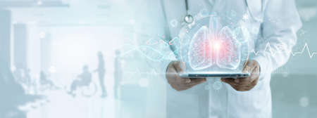 Healthcare and medicine, Covid-19, Doctor holding tablet and diagnose virtual Human Lungs with coronavirus spread inside on modern interface screen on hospital, Innovation and Medical technology. 版權商用圖片 - 161884088